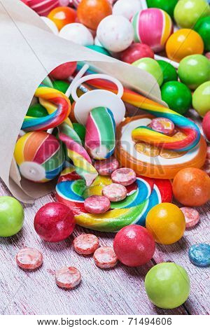 Multicolored Sweets And Chewing Gum In Paper Bags