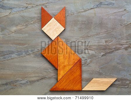 abstract picture of a cat built from seven tangram wooden pieces against slate rock background, a traditional Chinese puzzle game, the artwork copyright by the photographer