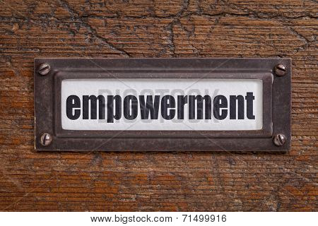 empowerment - file cabinet label, bronze holder against grunge and scratched wood