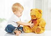 foto of cute innocent  - cute baby plays in doctor toy teddy bear and stethoscope - JPG