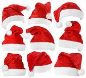 foto of tassels  - Set of red Santa Claus hats isolated on white background - JPG