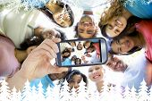 pic of huddle  - Hand holding smartphone showing friends forming huddle - JPG