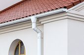 picture of downspouts  - Rain gutter and downspout on wall of house - JPG
