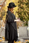 foto of snitch  - Young woman in mourning adorating husband