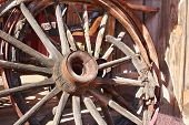 image of stagecoach  - Old broken down wagon wheel from the wild west - JPG