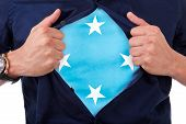 pic of mongol  - Young sport fan opening his shirt and showing the flag his country Micronesia Micronesian flag - JPG