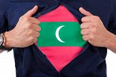 image of mongol  - Young sport fan opening his shirt and showing the flag his country Mauritius Mauritian flag - JPG