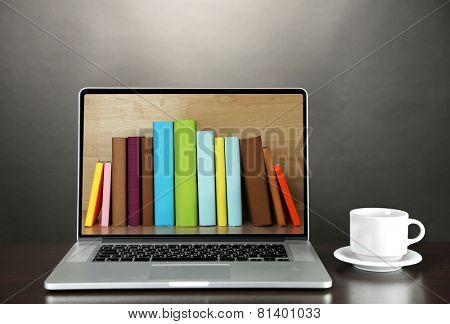 E-learning concept.  Digital library - books inside laptop