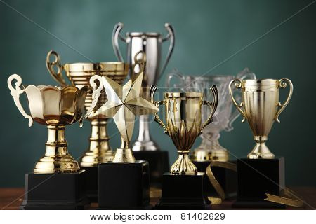 Group of the trophies on the green background