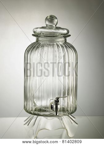 glass water dispenser on the gray background