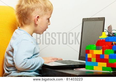 Little Boy Using Laptop Pc Computer At Home
