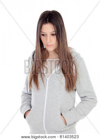 Sad teenager girl with gray sweatshirt isolated on white background