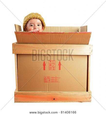 Little boy in a delivery package.