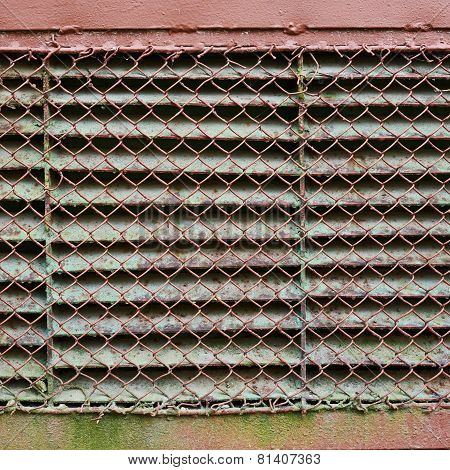 Old ventilation shaft covered with metal lattice