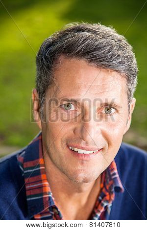 Closeup portrait of smiling man at campsite