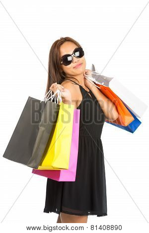 Asian Female Shopping Bags At Camera Half Tilt