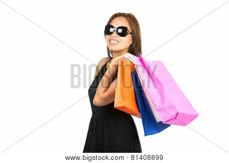Asian Shopping Bags Flung Over Shoulder Look Away