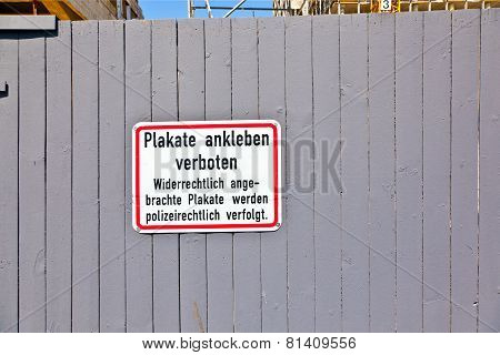 Grey Wooden wall with sign no posters