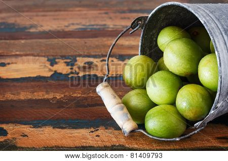 Brazilian Fruit Spondias Tuberosa (brazil Plum, Imbu, Umbu) In Small Bucket On Wooden Table