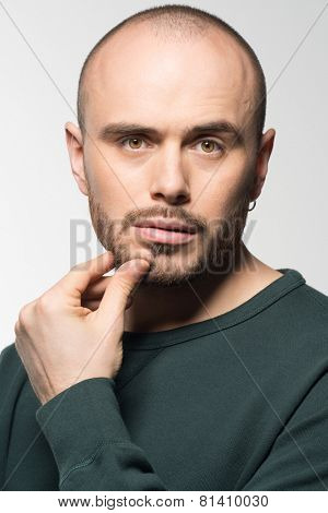 Portrait of young man being doubtful about something