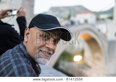 Senior Arabic Pakistani man traveling to Mostar in Bosnia
