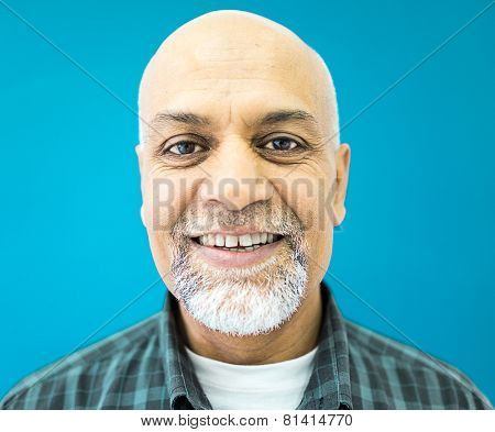 Senior Arabic Pakistani man studio portrait