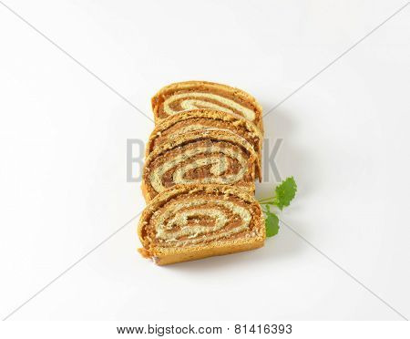 four slices of roll with nut filling