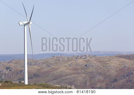 Windmill at windfarm - renewable electric energy production