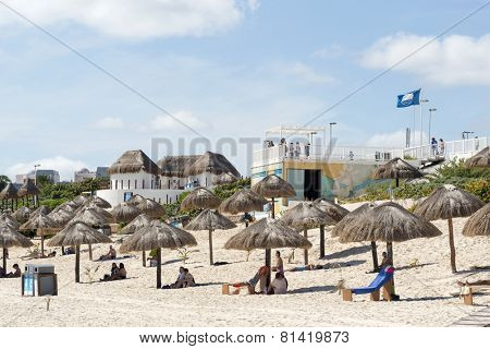 CANCUN - JANUARY 18: Tourists enjoy the sunny weather and relaxing on the Playa Delfines on 18 January 2015 in Cancun, Mexico. This is one of the best beaches in the Mexico.