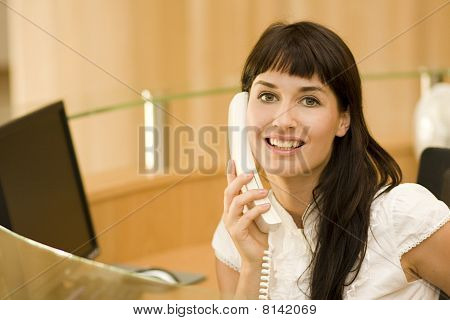 Young Atractive Woman  Recepionist With Phone