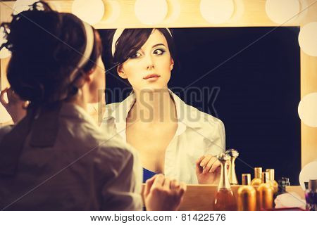 Portrait Of A Beautiful Woman Near A Mirror