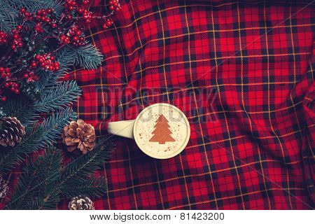 Cappuccino And  Pine Branch On Tartan Background
