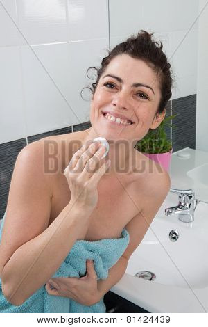 Brunette Woman Using Cotton Pads For Removing Makeup