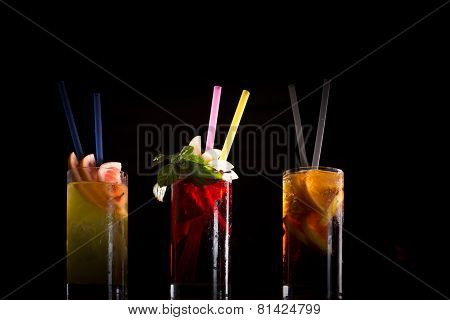 Cherry Bomb, Screwdriver And Cuba Libre Cocktails In A Tall Glasses