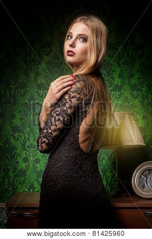 Sensual Woman In Black Dress On Green Vintage Interior