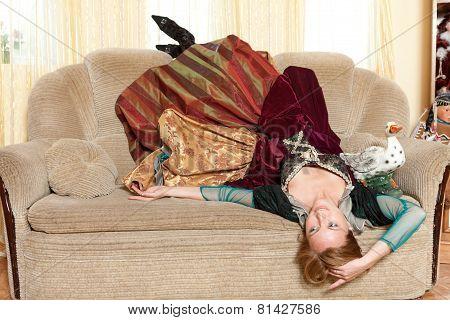 Artist Girl In Medieval Dress Lying On Sofa