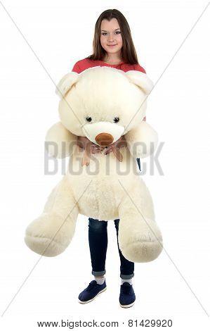 Teenage girl holding teddy bear in full lenght