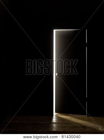 DARKENED ROOM DOOR SLIGHTLY OPEN