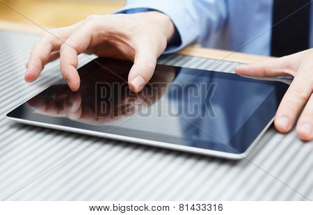 Businessman Moving Two  Fingers On Touchscreen On  Tablet Computer