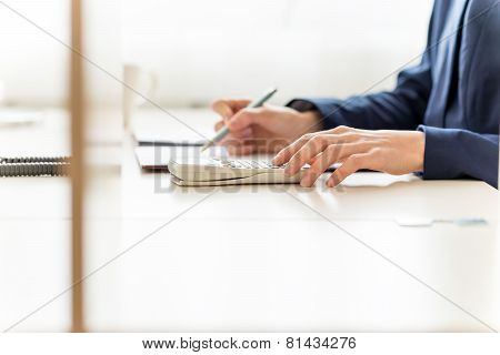 Businesswoman Checking And Analysing A Report