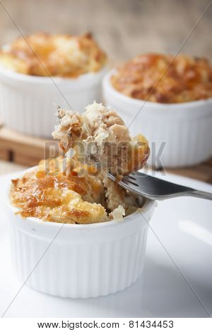 Mini potato casserole with red fish in a cocotte.