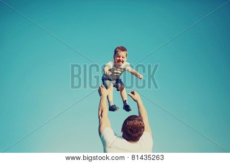 Vintage Photo Happy Father And Child Having Fun Outdoors