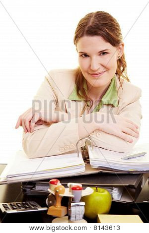 Content Woman At Her Desk