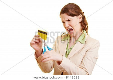 Angry Businesswoman Cutting A Credit Card