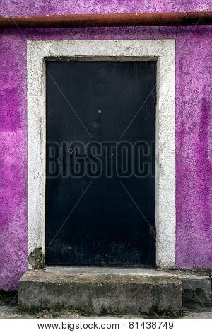 Locked door on the purple wall