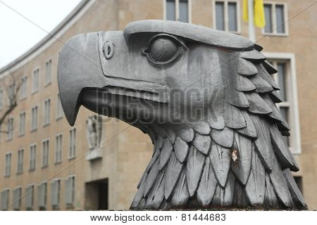 BERLIN, GERMANY - JANUARY 6, 2015: Head of German Eagle from the 1930s installed in front of the Tempelhof Airport in Berlin, Germany.