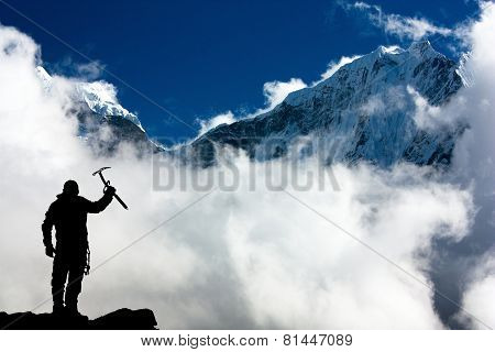 Silhouette Of Man With Ice Axe In Hand