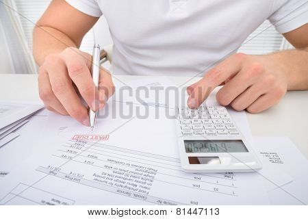 Man Calculating Past Due Statement