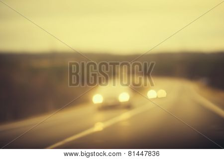 Road track and Cars headlights Background Blurred Travel