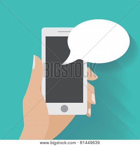Hand holding black smartphone with blank speech bubble for text